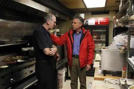 U.S. Republican presidential candidate and former Utah Governor Jon Huntsman (R) chats with Stephen Luce, owner the Main Street Station Diner, in the kitchen during a campaign event in Plymouth, New Hampshire January 7, 2012. REUTERS/Jessica Rinaldi