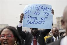 A member of the Nigerian Bar Association holds up a placard to protest a fuel subsidy removal in Lagos January 5, 2012.  REUTERS/Akintunde Akinleye