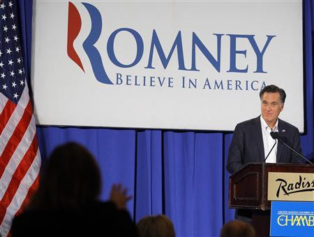 Republican presidential candidate and former Massachusetts Governor Mitt Romney listens to a question from UAW representative Julie Kushner (L) during a speech before the Nashua Chamber of Commerce in Nashua, New Hampshire January 9, 2012, one day before New Hampshire's first-in-the-nation primary election.   REUTERS/Brian Snyder