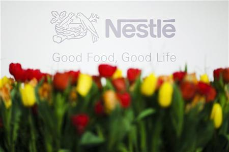 A Nestle logo is pictured before the news conference announcing their 2010 full-year results, at Nestle's headquarters in Vevey, February 17, 2011. REUTERS/Valentin Flauraud