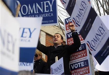 A supporter of Republican presidential candidate and former Massachusetts Governor Mitt Romney chants outside a polling station in Manchester, New Hampshire January 10, 2012. REUTERS/Adam Hunger