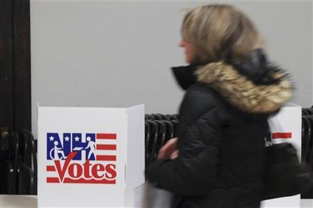 A voter walks to the ballot box to cast her ballot in the first in the nation's presidential primary at the Newfields, New Hampshire Town Hall January 10, 2012.    REUTERS/Neal Hamberg