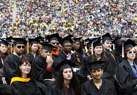 Graduating students listen to President Barack Obama speak at the University of Michigan commencement ceremony in Ann Arbor, Michigan May 1, 2010. REUTERS/Kevin Lamarque