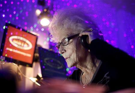 DJ Wika Szmyt plays music at a club in Warsaw January 4, 2012. Szmyt, 73, spends her retirement days behind a DJ console watching people dance to her rhythms. REUTERS/Kacper Pempel