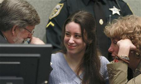 Casey Anthony (C) smiles at Defense Counsel Cheney Mason and Dorothy Clay Sims, before her sentencing at the Orange County Courthouse in Orlando, Florida, July 7, 2011.  REUTERS/Joe Burbank/Pool