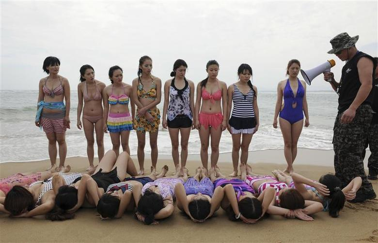 a7ec933c21 <p>Trainees dressed in swimming suits follow the instructions of a trainer  from Tianjiao