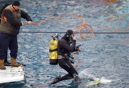 Italian cave divers race against time to find survivors on ship