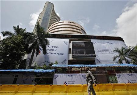 A man walks past the Bombay Stock Exchange (BSE) building in Mumbai September 21, 2010. REUTERS/Danish Siddiqui/Files