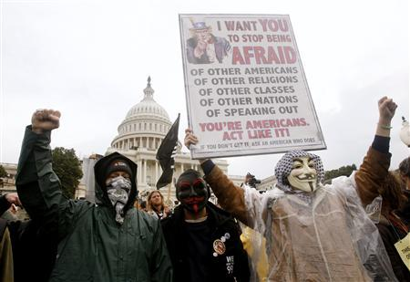 Occupy Congress/DC protesters hold up a sign in front of the U.S. Capitol during a rally in Washington, January 17, 2012. Day-long rallies will continue through today.      REUTERS/Gary Cameron