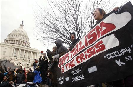 Occupy Congress/DC protesters hold a banner in front of the U.S. Capitol during a rally in Washington, January 17, 2012.   REUTERS/Gary Cameron