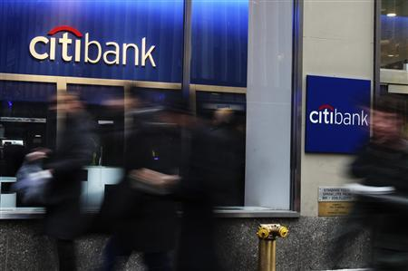 People walk by a Citibank branch in New York January 17, 2012. REUTERS/Shannon Stapleton