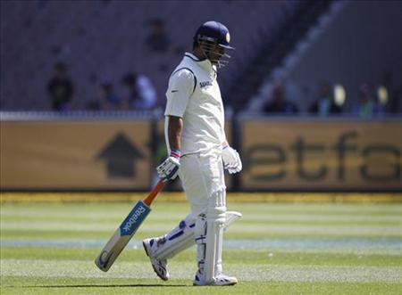India's captain Mahendra Singh Dhoni walks from the field after being bowled by Australia's James Pattinson during the first cricket test match, at the Melbourne Cricket Ground December 29, 2011. REUTERS/Tim Wimborne