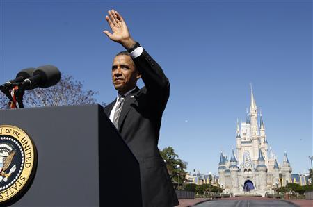 U.S. President Barack Obama waves as he speaks in front of Cinderella's Castle at Disney World's Magic Kingdom in Orlando January 19, 2012. REUTERS/Kevin Lamarque