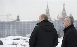 """<p>Russia's Prime Minister Vladimir Putin (L) and Moscow's Mayor Sergei Sobyanin visit the construction site, where the """"Rossiya"""" (Russia) Hotel was situated and later demolished, near the Kremlin in central Moscow January 20, 2012. REUTERS/Alexsey Druginyn/RIA Novosti/Pool</p>"""