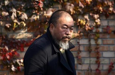 Dissident Chinese artist Ai Weiwei walks to the door of his home after talking to his lawyers in Beijing November 14, 2011. REUTERS/David Gray/Files
