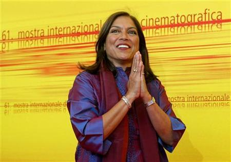 Indian director Mira Nair poses during a photo call at the Venice Lido September 5, 2004. REUTERS/Alessia Pierdomenico/Files