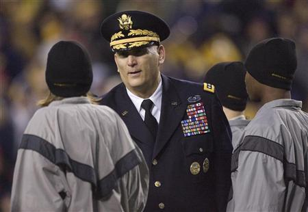 U.S. Army Chief of Staff General Ray Odierno (C) greets new Army recruits after leading them in their oath during an on-field induction ceremony during the second half of the 112th Army-Navy football game in Landover, Maryland, December 10, 2011.  REUTERS/Jonathan Ernst