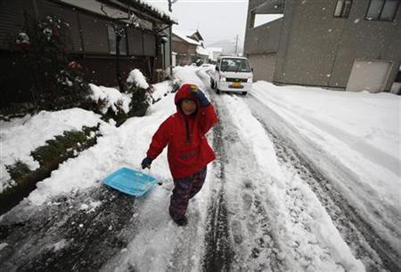 Local resident Keita Hamada, 6, sleighs in Ohi town, near Kansai Electric Power Co's Ohi nuclear power plant, Fukui prefecture January 26, 2012. REUTERS/Issei Kato