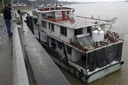 The Chinese cargo ship Hua Ping sits abandoned at a jetty near the Thai port of Chiang Saen in the Golden Triangle region where the borders of Thailand, Myanmar and Laos meet January 14, 2012.REUTERS/Sukree Sukplang