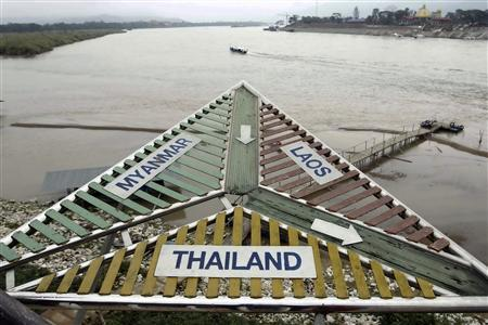 A signboard at the Thai village of Sop Ruak on the Mekong river in the Golden Triangle region where the borders of Thailand, Laos and Myanmar meet January 14, 2012.  REUTERS/Sukree Sukplang