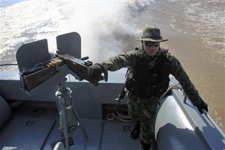 Thai marines patrol the Mekong river near Sop Ruak in the Golden Triangle region where the borders of Thailand, Laos and Myanmar meet January 18, 2012.  REUTERS/Sinthana Kosolpradit