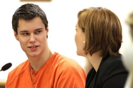 Colton Harris-Moore (L), the Barefoot Bandit, talks with one of his lawyers at his sentencing in Island Superior Court in Coupeville, Washington in this December 16, 2011 file photograph.   REUTERS/Marcus Donner/Files