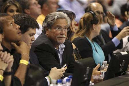 Chief Executive Officer of Carnival Corporation, the world's largest cruise operator, and owner of the NBA's Miami Heat Micky Arison watches his team defeat the New York Knicks 99-89 in their NBA basketball game in Miami, Florida, January 27, 2012.    REUTERS/Robert Sullivan