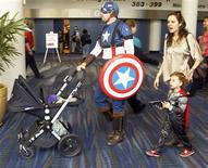 "<p>Eric Royster (L) in costume as ""Captain America"" walks with his wife Andrea O'Leary and 4-year-old daughter Isabella as they enjoy the pop culture convention Comic Con in New Orleans, Louisiana January 28, 2012. REUTERS/Bill Haber</p>"