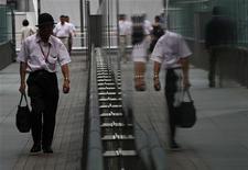A man walks on a street in Tokyo August 24, 2011. REUTERS/Issei Kato