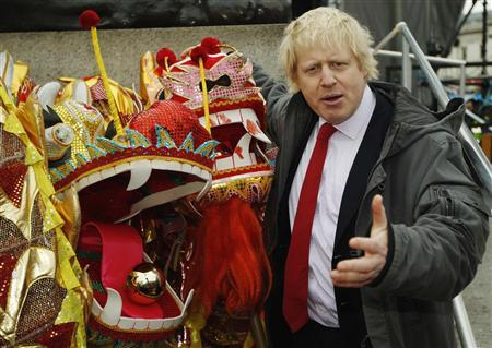 London's Mayor Boris Johnson poses with dragon puppets during festivities to celebrate the Chinese New Year of the Dragon at Trafalgar Square in London January 29, 2012.    REUTERS/Luke MacGregor