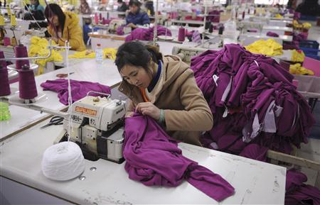 Employees work at a garment factory in Wuhu, Anhui province February 1, 2012.  REUTERS/Stringer