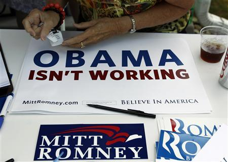 A supporter of Mitt Romney signs in guests in Des Moines, Iowa, August 10, 2011. REUTERS/Jim Young
