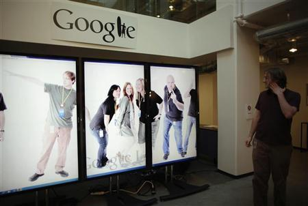 Software Engineer for Google+ mobile photos Ken Arthur, 27, views a scrolling employee photo collage that he helped develop in the 20% of his work time which Google employees can devote to personal projects, at the Google campus near Venice Beach, in Los Angeles, California January 13, 2012. REUTERS/Lucy Nicholson