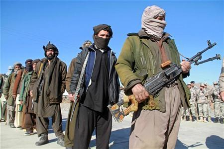 Taliban militants hand over their weapons after joining the Afghan government's reconciliation and reintegration program, in Herat January 30, 2012. REUTERS/Mohammad Shoiab