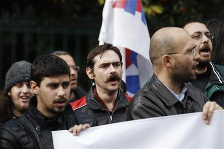 Demonstrators from the communist-affiliated trade union PAME protest outside the Greek Prime Minister's office in Athens February 4, 2012. REUTERS/Yiorgos Karahalis