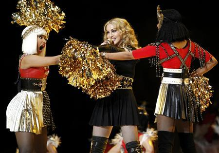 Madonna performs during the halftime show with Nicki Minaj (L) and M.I.A. in the NFL Super Bowl XLVI football game in Indianapolis, Indiana, February 5, 2012. REUTERS/Mike Segar