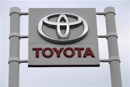 A Toyota logo is pictured at the Toyota car dealership Amserv in Tallinn November 22, 2011. REUTERS/Ints Kalnins/Files