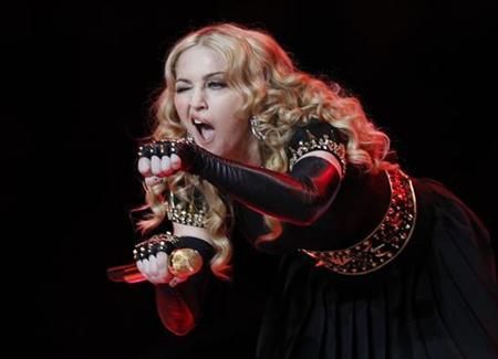 Singer Madonna performs during the halftime show at the NFL Super Bowl XLVI football game between the New York Giants and the New England Patriots in Indianapolis, Indiana, February 5, 2012. REUTERS/Mike Segar
