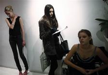 <p>Models wait in line during a casting call for designer Vivienne Tam's runway show that will happen during the upcoming fashion week, in New York, February 3, 2012. REUTERS/Carlo Allegri</p>
