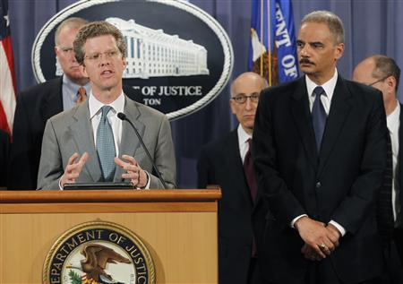 U.S. Attorney General Eric Holder (R) and U.S. Housing and Urban Development Secretary Shaun Donovan (at podium) announce February 9, 2012 in Washington that the federal government and 49 state attorneys general have reached a $25 billion agreement with the nation's five largest mortgage servicers to address mortgage loan servicing and foreclosure abuses. REUTERS/Gary Cameron