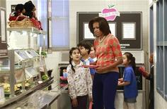 <p>U.S. First Lady Michelle Obama joins the lunch line at Parklawn Elementary School in Alexandria, Virginia January 25, 2012. REUTERS/Kevin Lamarque</p>