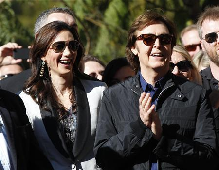 British Singer Paul McCartney Applauds Next To His Wife Nancy Shevell Before Unveiling Star On The Walk Of Fame In Hollywood California February 9