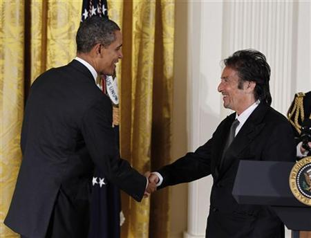 U.S. President Barack Obama (L) honors actor Al Pacino, a National Medal of Arts recipient, at a ceremony in the East Room of the White House in Washington, February 13, 2012. REUTERS/Jason Reed