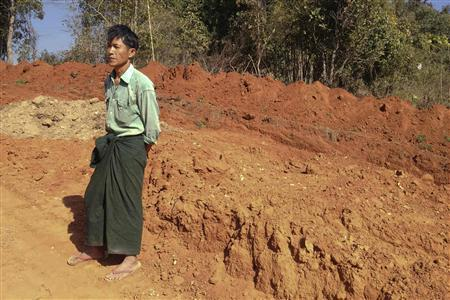 Farmer U Thant Lwin stands on the site of his old paddy field, which has been ripped apart to make way for a gas pipeline to China, near the northeastern Myanmar town of Pyin Oo Lwin January 23, 2012. Picture taken January 23, 2012. REUTERS-Staff