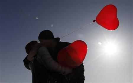 A couple kisses during a flashmob on the eve of Valentine's Day in the southern Russian city of Stavropol February 13, 2012. REUTERS/Eduard Korniyenko