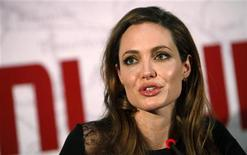 """U.S. actress and director Angelina Jolie speaks during a news conference before the gala premiere of the movie """"In The Land Of Blood And Honey"""" in Sarajevo February 14, 2012. REUTERS/Dado Ruvic"""