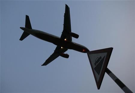 A plane prepares to land at an airport in New Delhi June 4, 2008. REUTERS/Adnan Abidi/Files