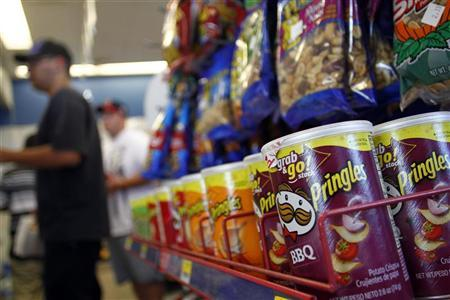 Containers of Pringles chips, a product of Procter & Gamble, are displayed at a gas station in Phoenix, Arizona October 27, 2011. REUTERS/Joshua Lott/Files