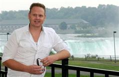 Nik Wallenda speaks to the media after a meeting with officials from the state's parks department, in anticipation of a high wire walk across the gorge to Canada, at Niagara Falls, New York in this August 3, 2011, file photo.   REUTERS/Doug Benz/Files