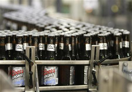 Thousands of newly-labelled bottles of Coors Light beer head for packaging at the Coors brewery in Golden, Colorado October 16, 2007. REUTERS/Rick Wilking